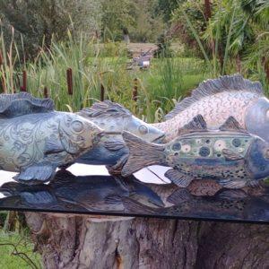 Rzeźby ryb w Ogródzie Freya